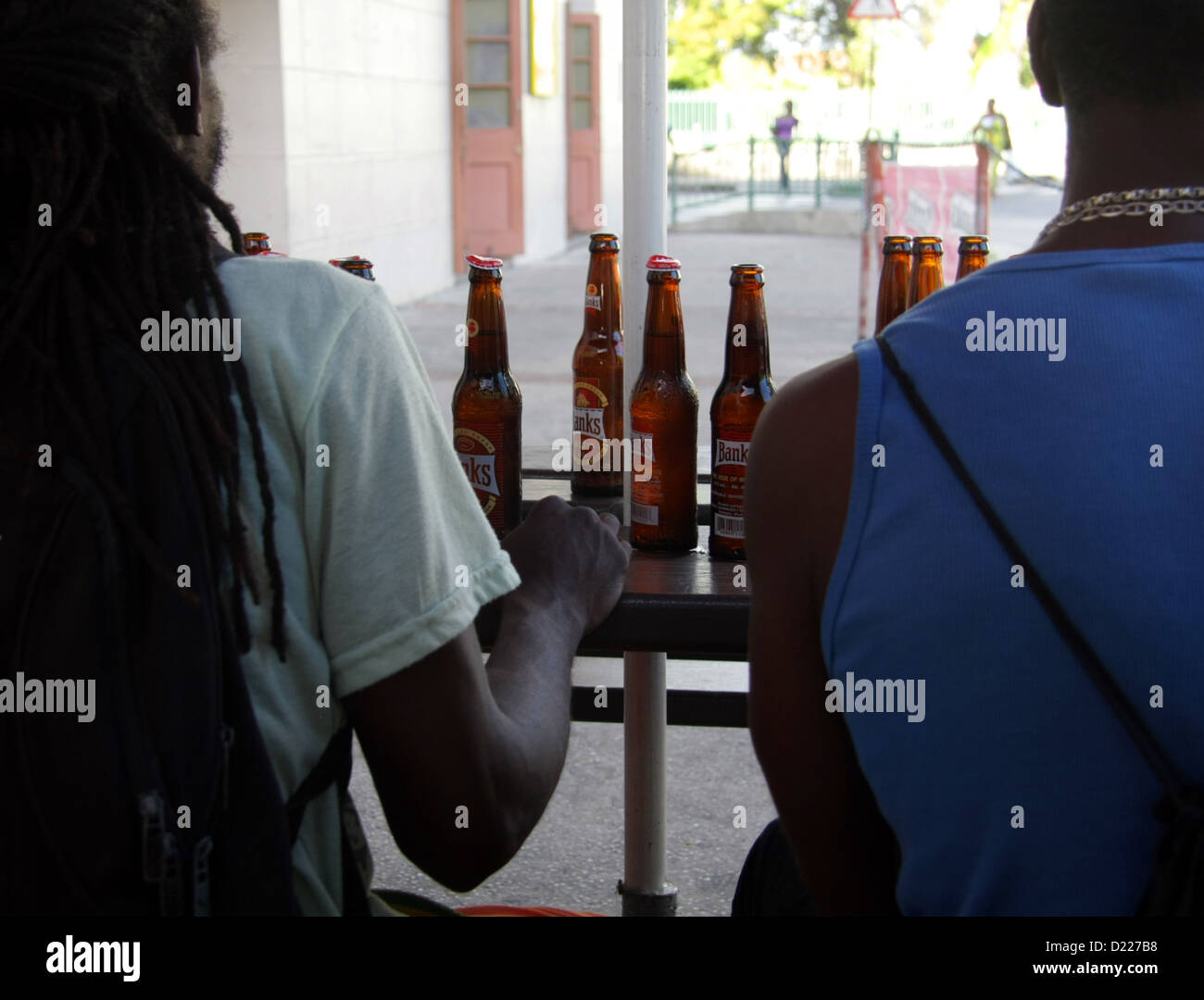 table full of Banks beer at a bar in Bridgetown Barbados - Stock Image