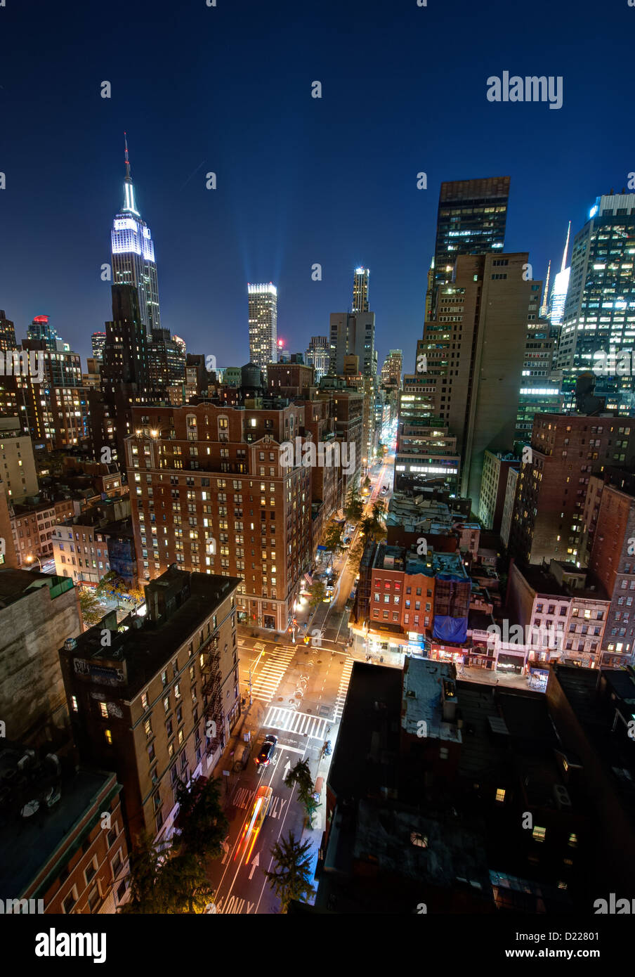 The skyline of midtown Manhattan seen at night. - Stock Image