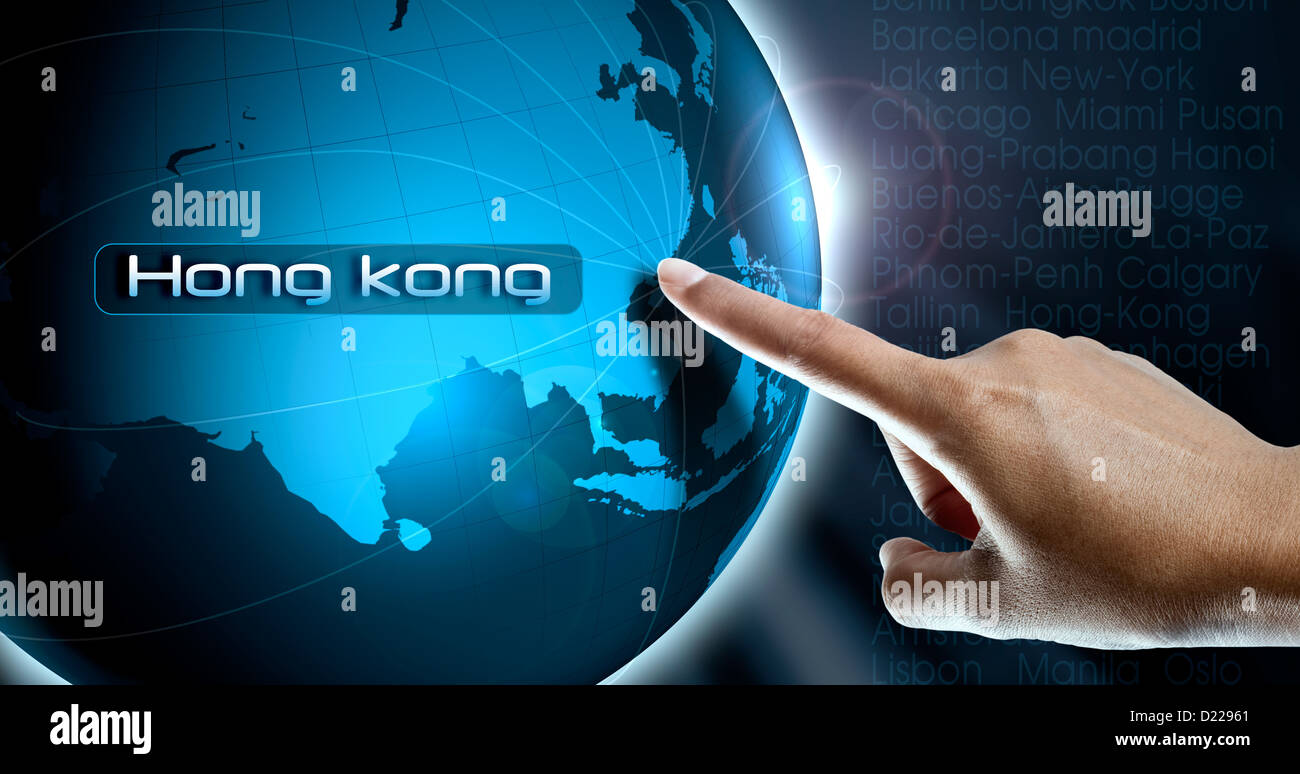 a finger of woman point the city hong kong china asia on a world map to choice a destination