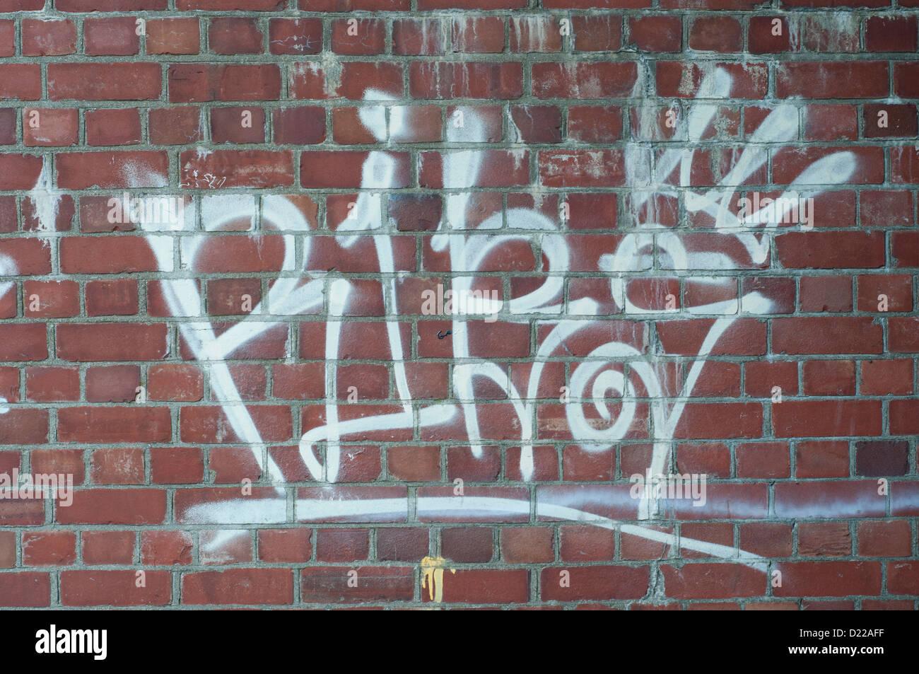 Graffiti on red brick wall stock image