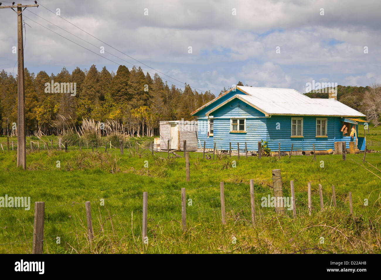 An old colourful, single storey wooden house in rural Canterbury, South Island, New Zealand. Stock Photo