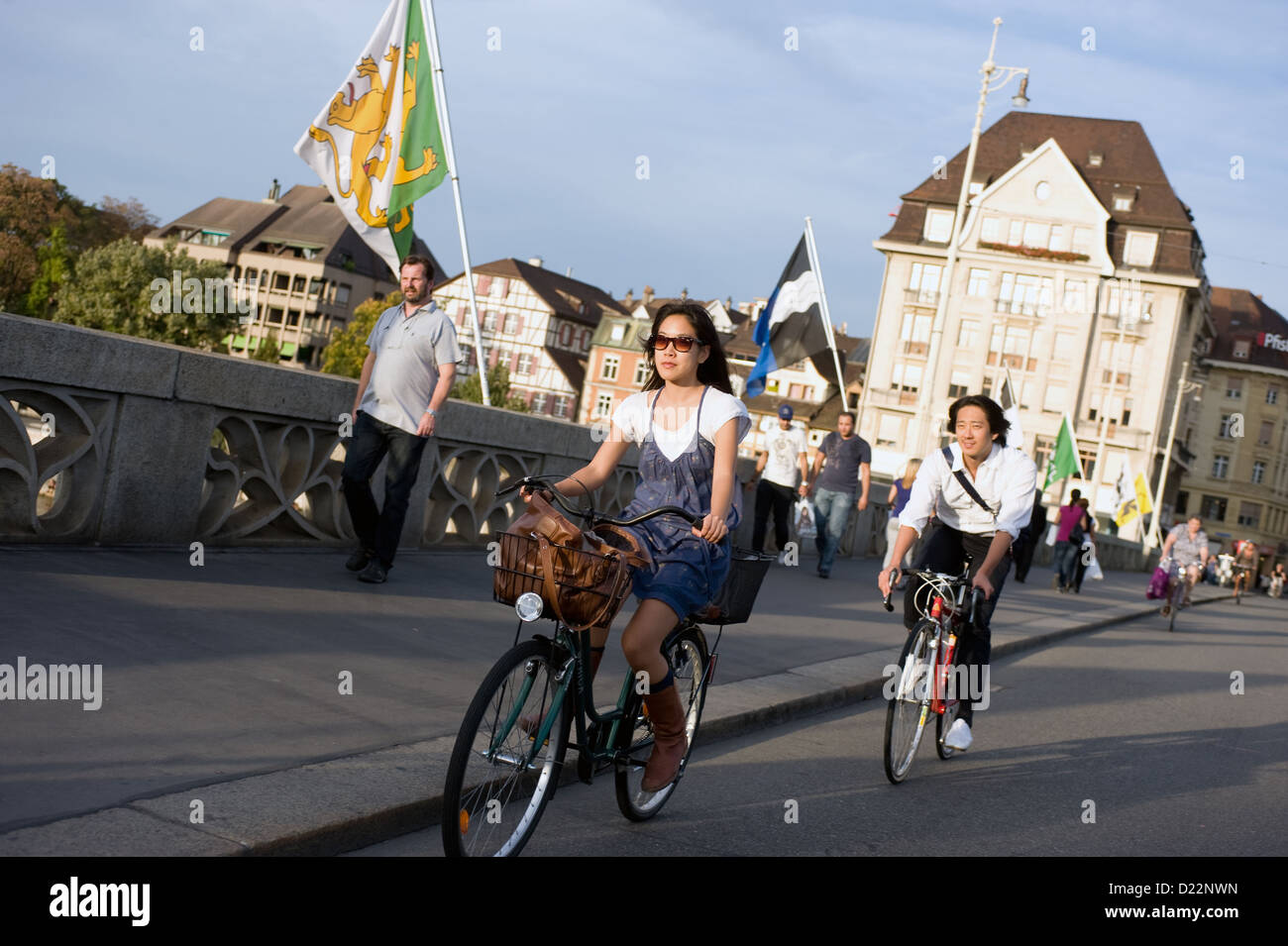 Basel, Switzerland, passersby and flags of the Basel communities on the Middle bridge Stock Photo