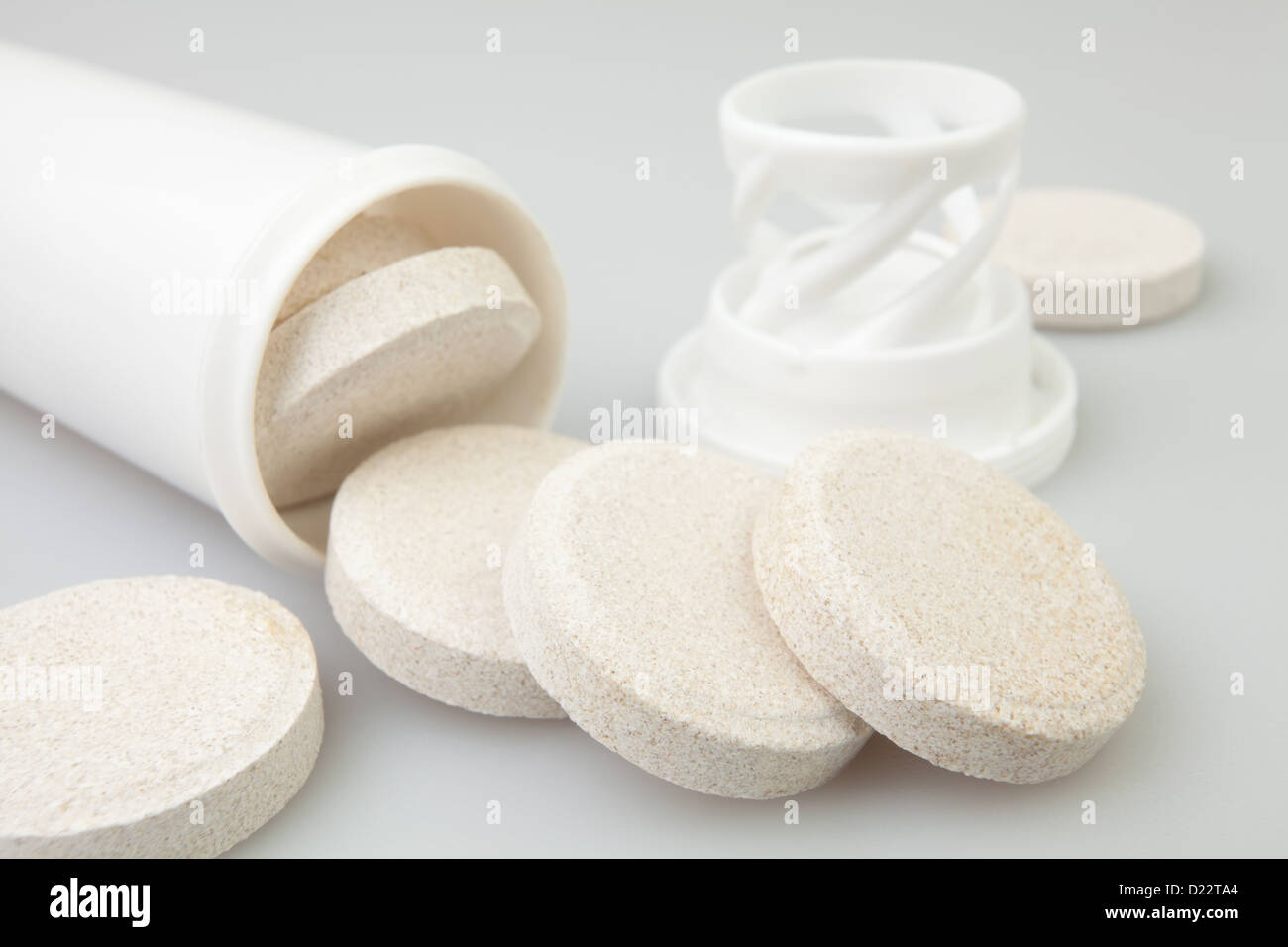vitamin pill tablet package on gray - Stock Image