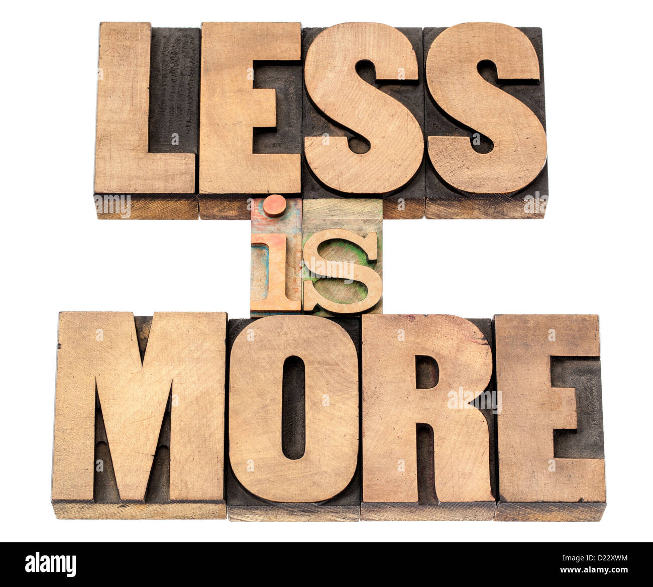 less is more - efficiency concept - isolated text in vintage letterpress wood type printing blocks - Stock Image