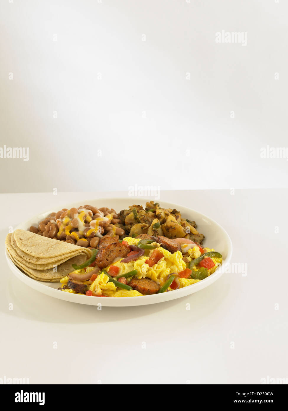 Mexican egg scramble with sausage and tortillas - Stock Image
