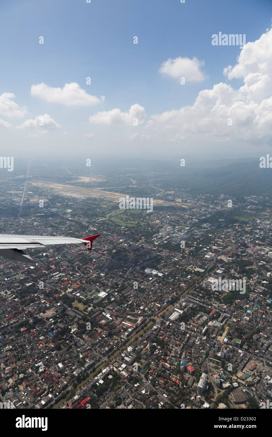 flying over Chiang Mai city in north Thailand Stock Photo