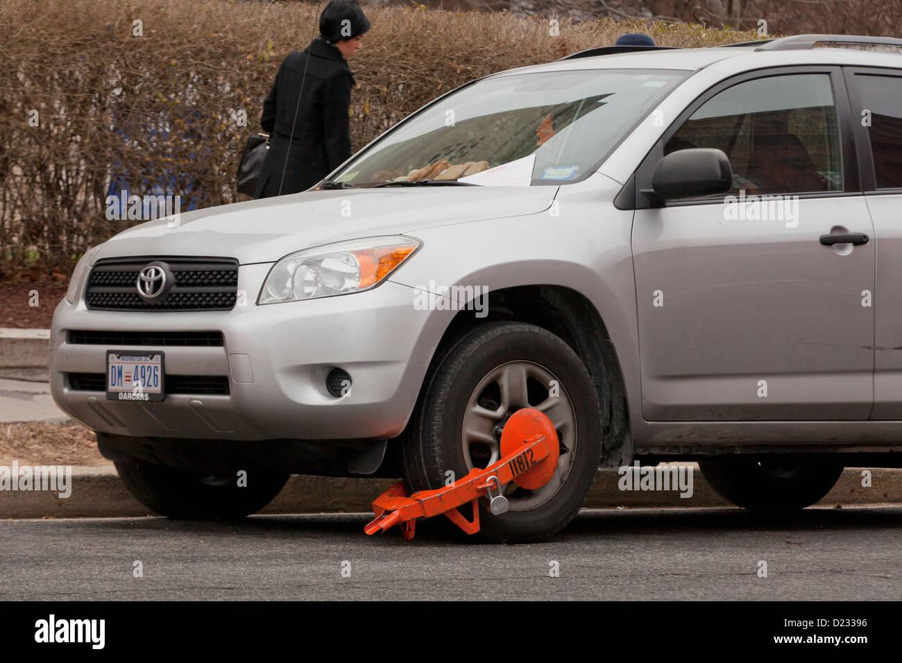 Wheel lock on car - USA - Stock Image