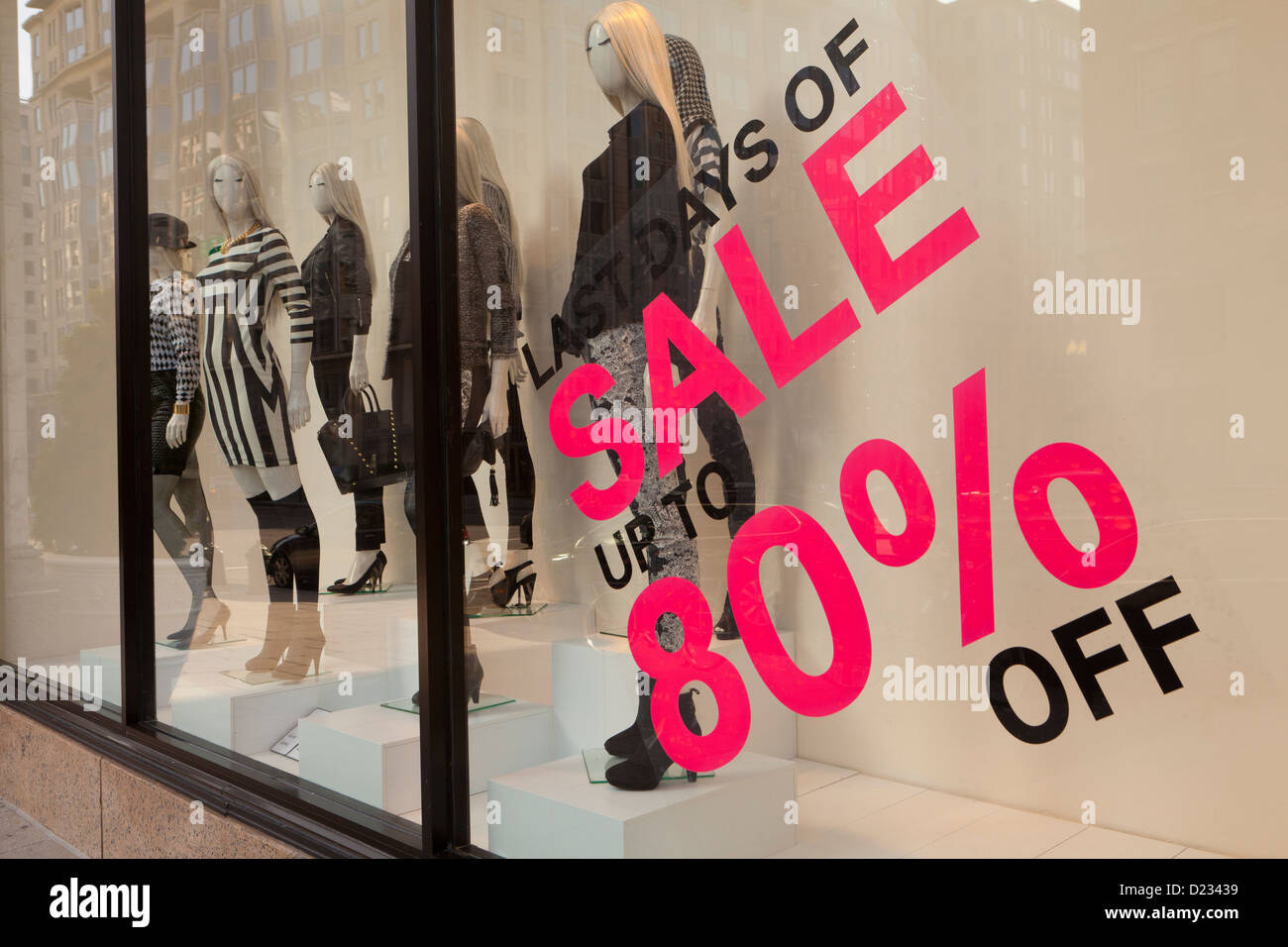 80% off sale sign on clothing store window display - USA - Stock Image