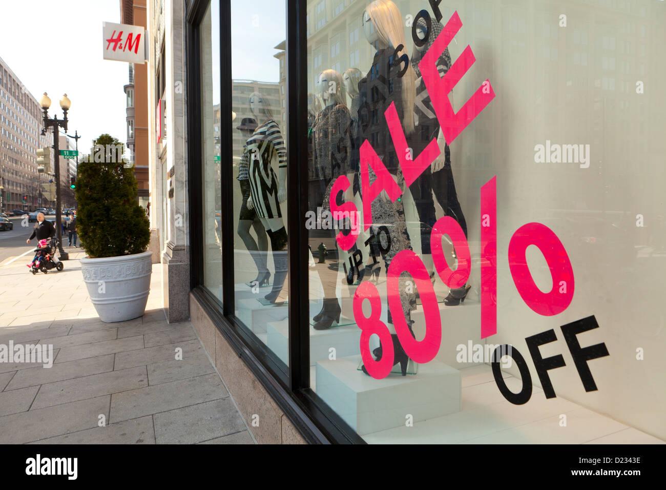 80% off sale sign on H&M clothing store window display - Washington, DC USA - Stock Image