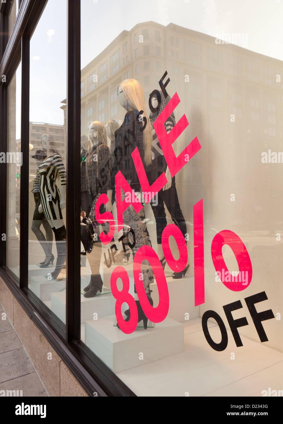 80% off sale sign on clothing store window display - Washington, DC USA - Stock Image