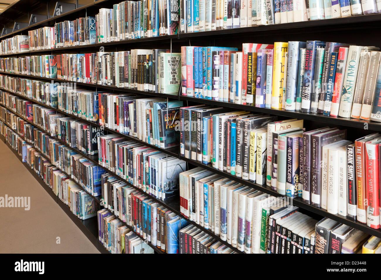 Library shelves full of books USA - Stock Image
