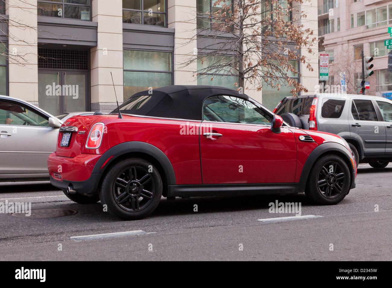 Red Mini Cooper convertible - Stock Image