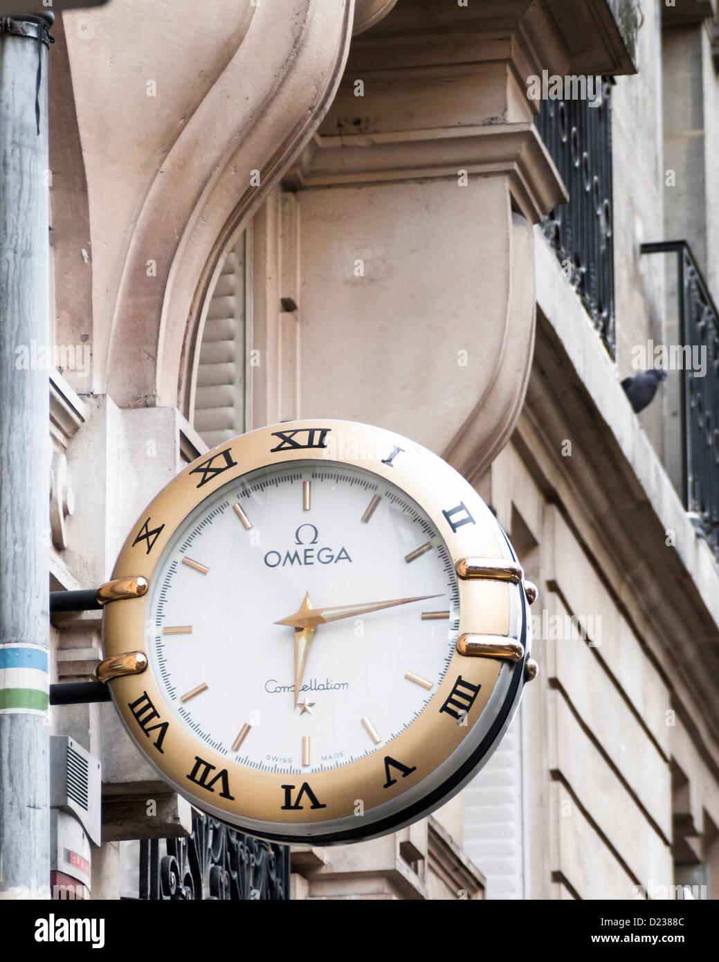 Paris France Europe Large Omega watch clock timepiece shop sign logo - Stock Image