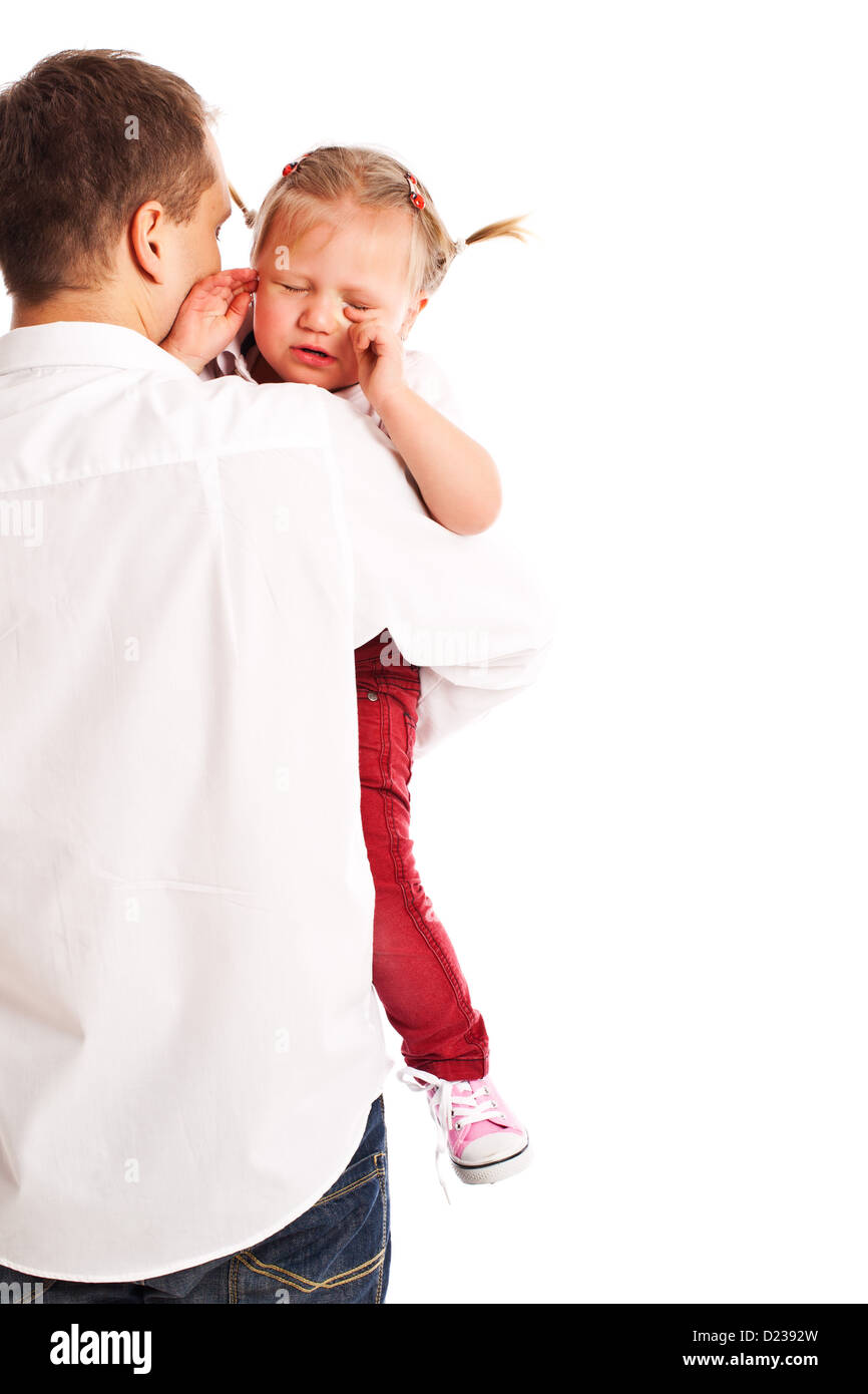 the crying baby in the arms of his father - Stock Image