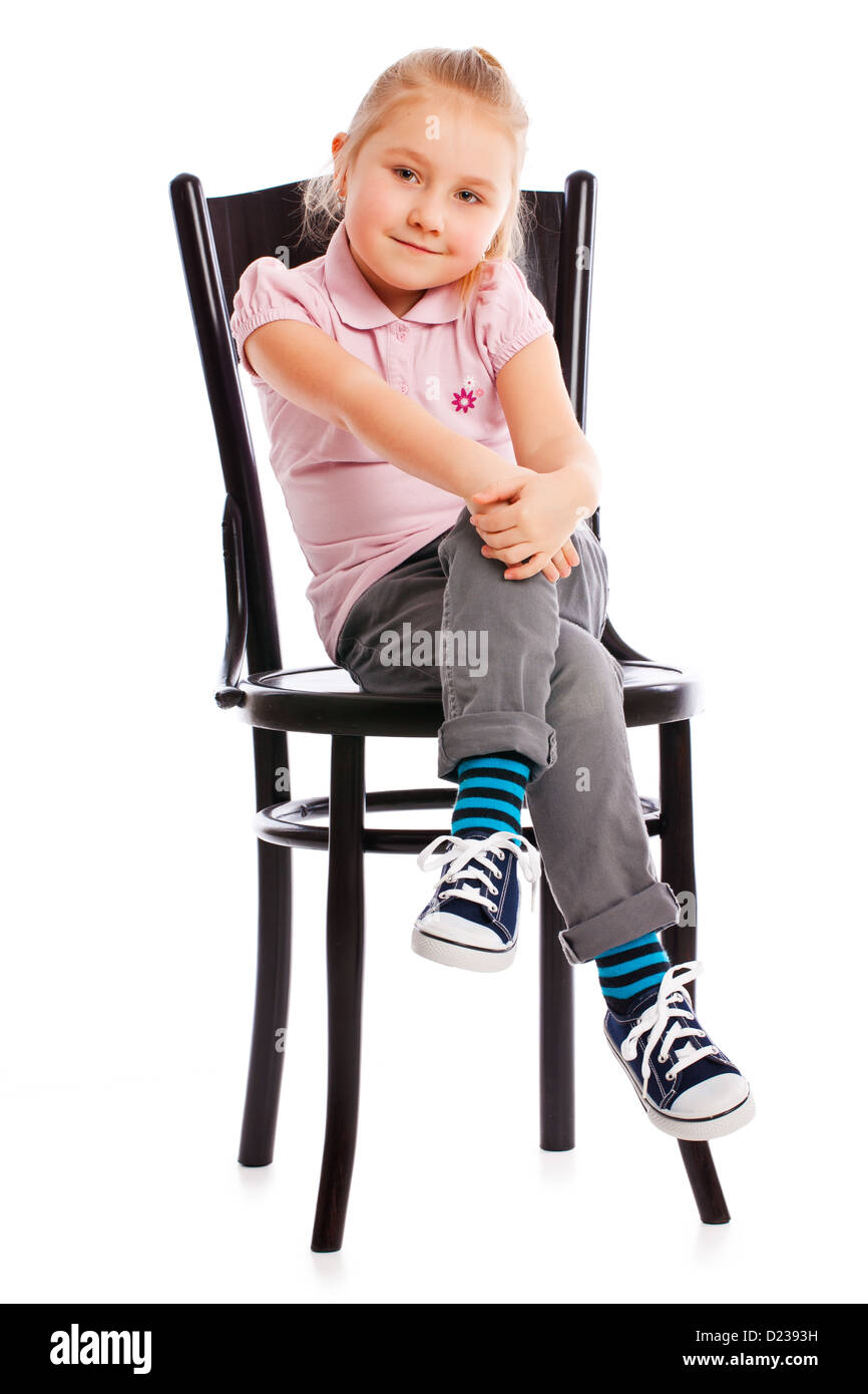 the little girl posing on antique chair - Stock Image