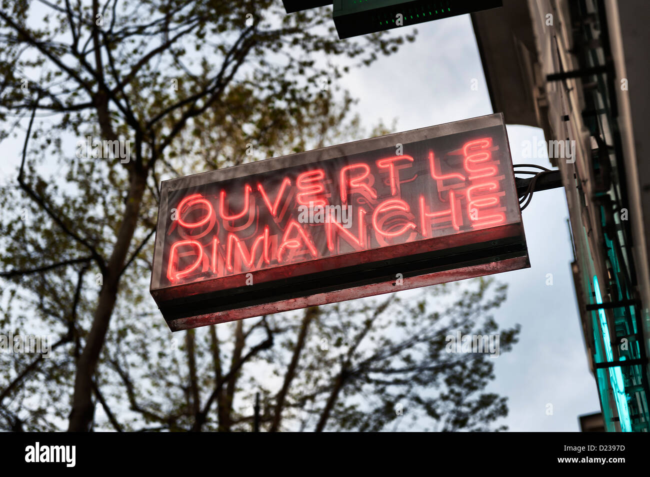 PARIS, FRANCE: Ouvert le dimanche (open on Sundays) - shop sign - Stock Image