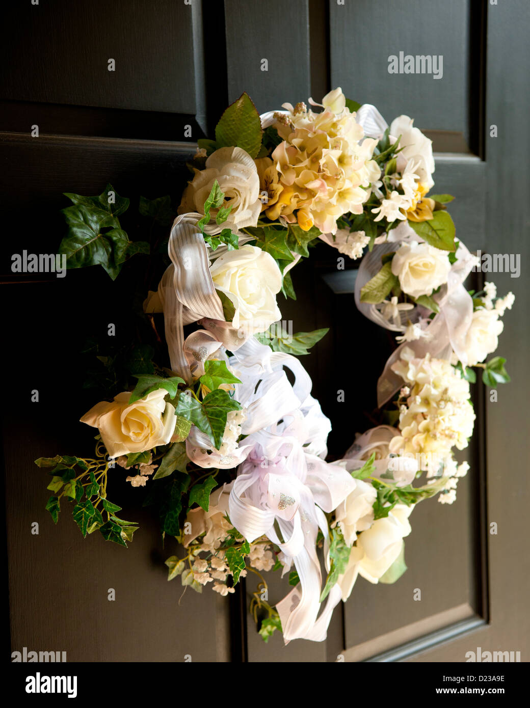 A wreath of white flowers on a black door wedding garland stock a wreath of white flowers on a black door wedding garland mightylinksfo
