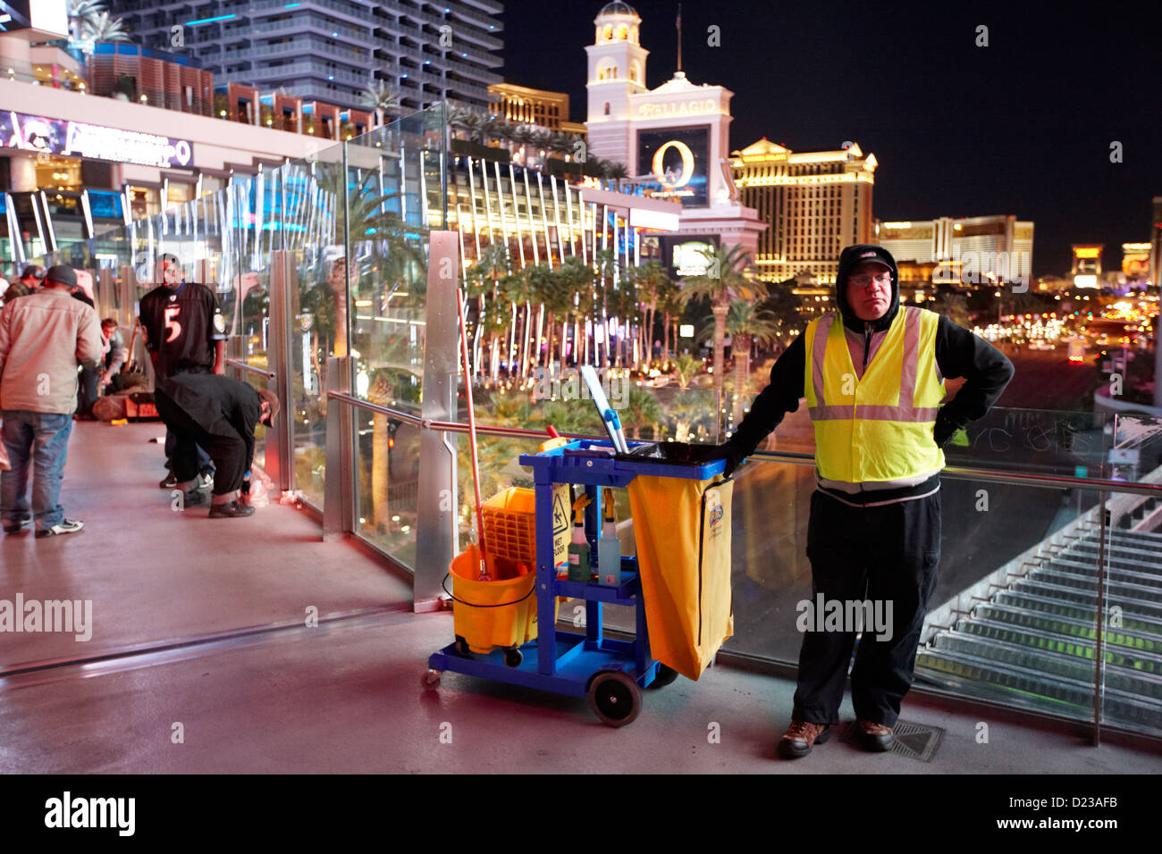 member of street cleaning team standing on overhead walkway las vegas boulevard nevada usa - Stock Image