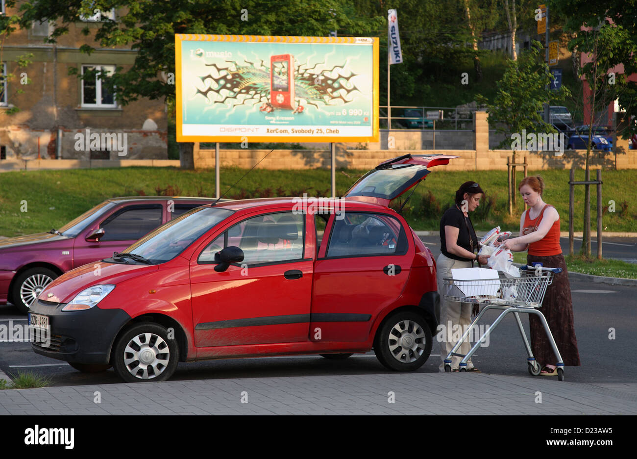Cheb, Czech Republic, women pack their shopping into the car - Stock Image