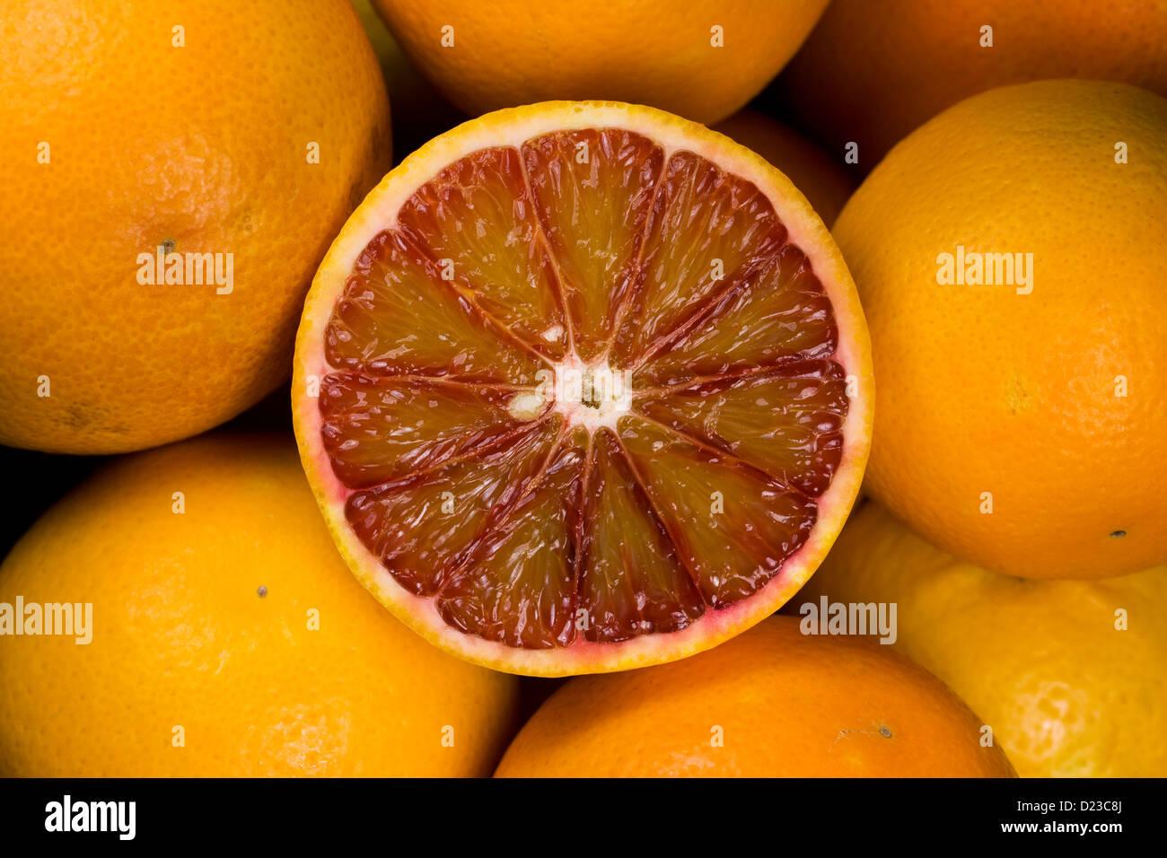 Citrus x sinenesis. Blood Oranges in a fruit bowl. - Stock Image