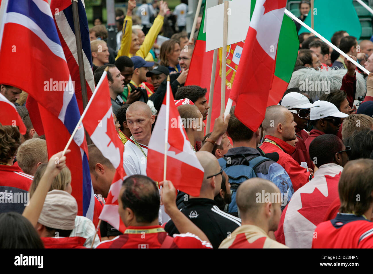Players and fans parade with their national flags at Homeless World Cup football tournament held in Edinburgh, Scotland - Stock Image