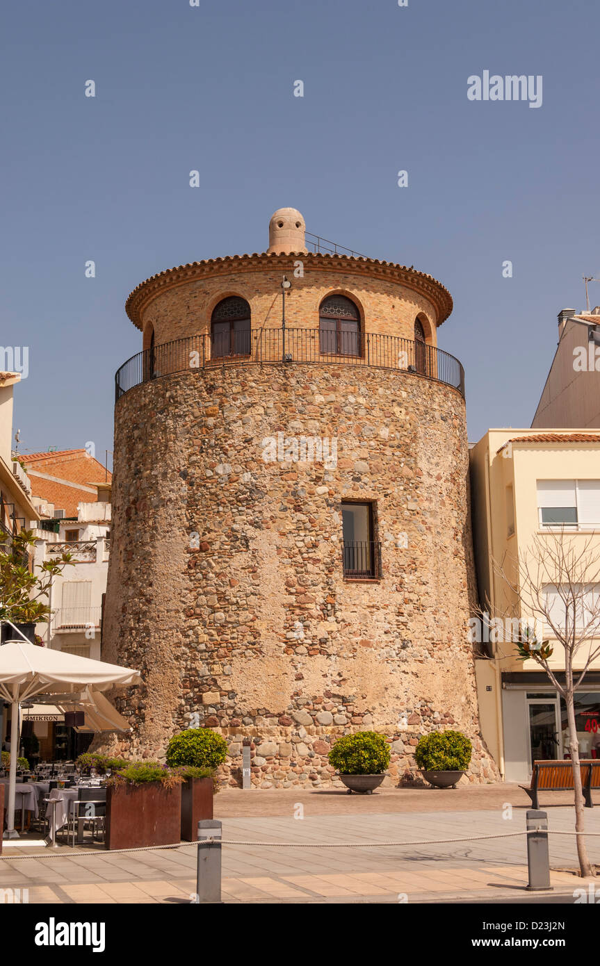 The old watch tower in the fishing port of Cambrils , Costa Dorada , Spain - Stock Image