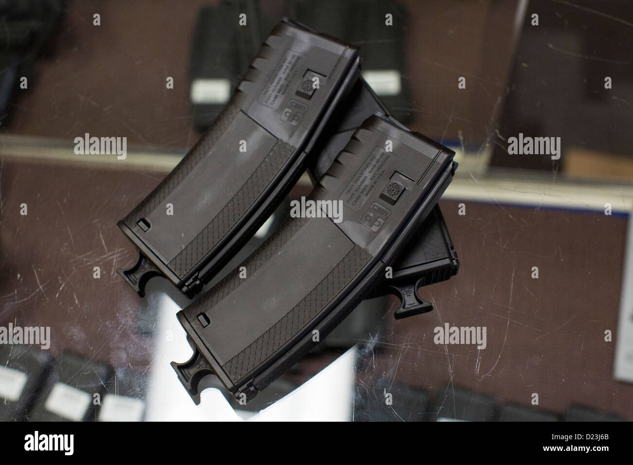 High capacity 30 round assault rifle magazines on display at a gun shop.  - Stock Image