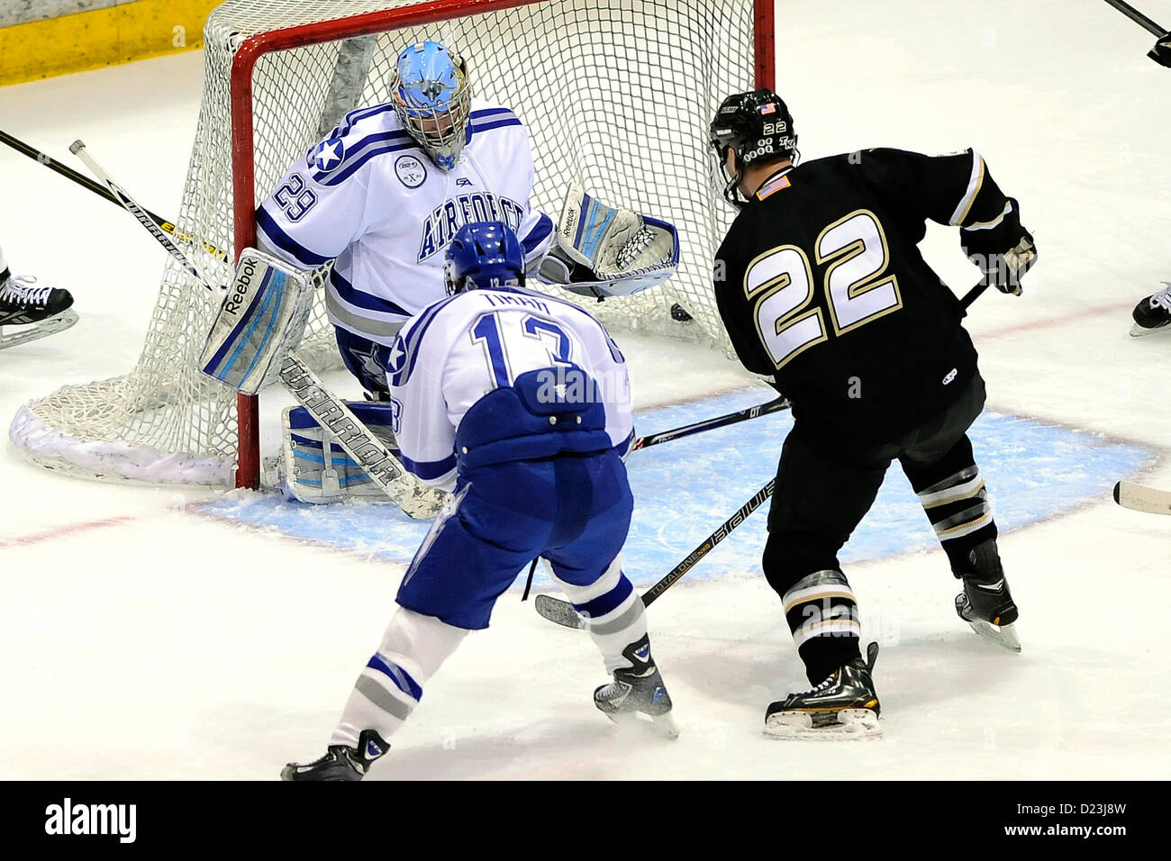 Army's Thane Heller gets one past Air Force goaltender Jason Torf as the Air Force Falcons met the Army Black - Stock Image