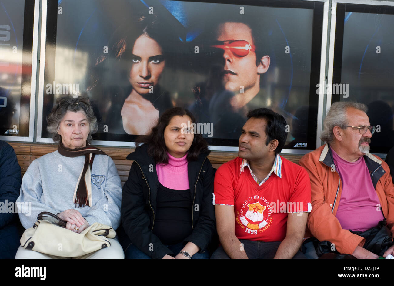 Zurich, Switzerland, locals and foreigners together on a bench - Stock Image