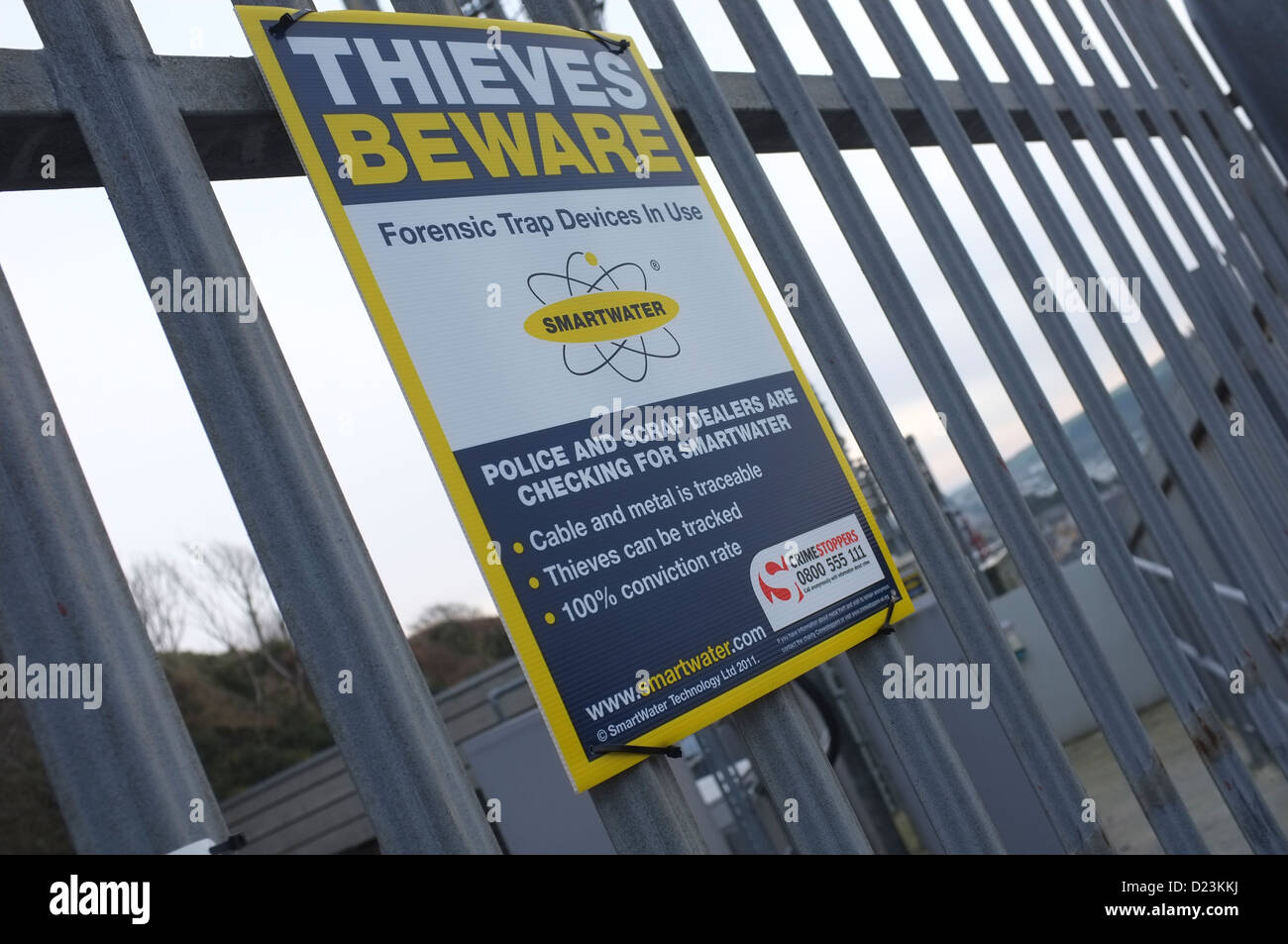 A sign warning scrap metal thieves of Smartwater 'forensic trap devices' in use, UK - Stock Image
