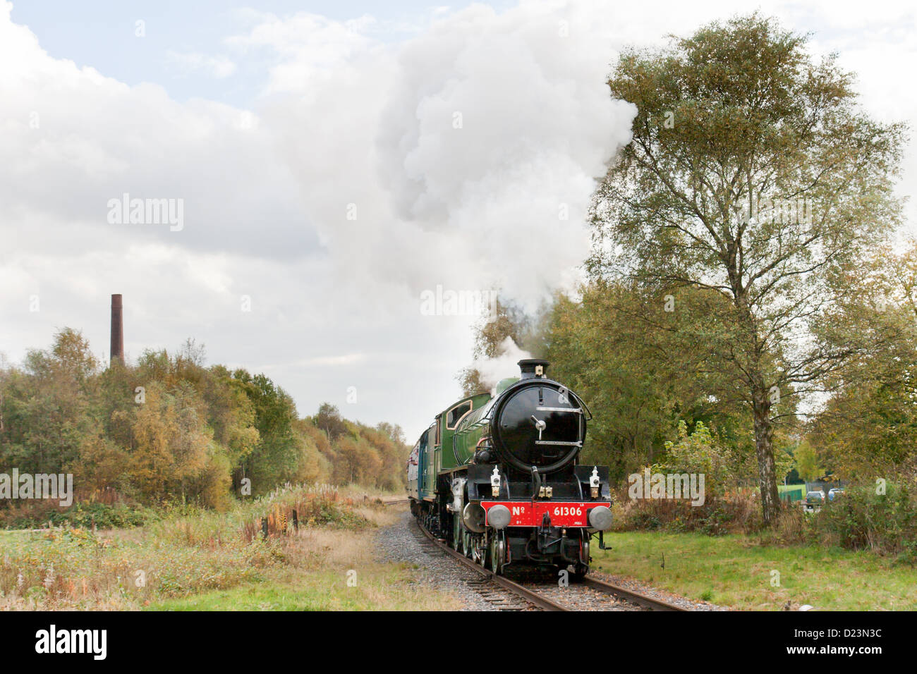 Steam locomotive pulling a passenger train on the East Lancs Railway at Ramsbottom - Stock Image
