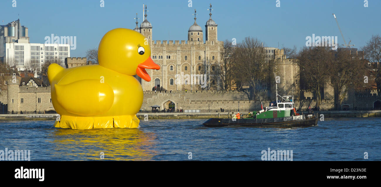 Yellow duck stunt on River Thames being towed past the Tower of London promoting the Jackpotjoy bingo website - Stock Image