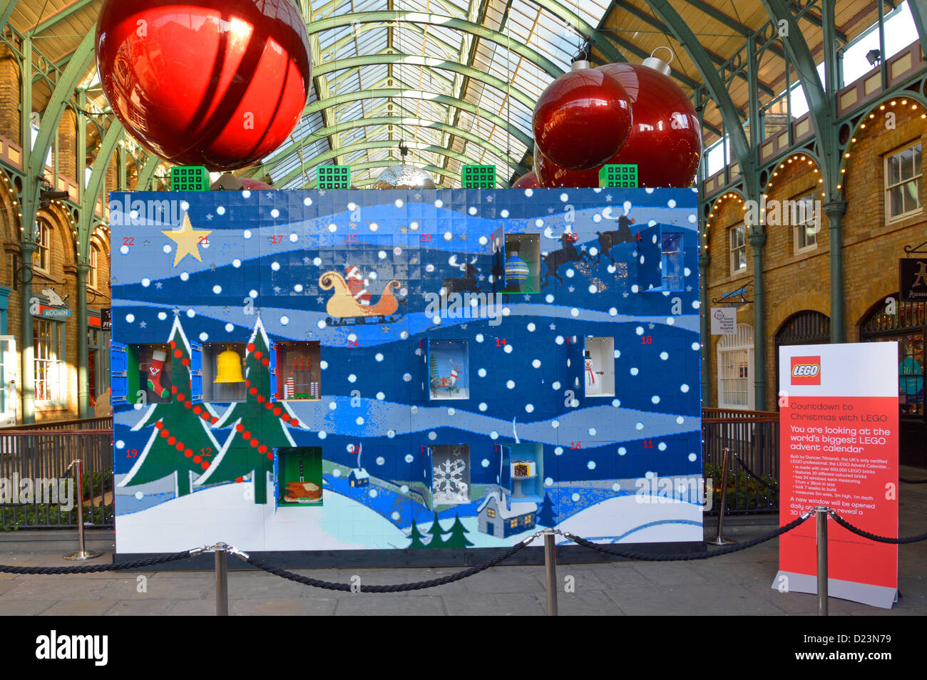 Xmas advent calendar made from 600,000 Lego bricks with open windows with other Christmas decorations Covent Garden - Stock Image