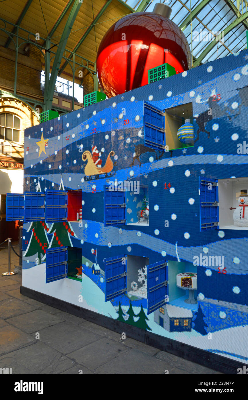 Lego Christmas advent calendar made from 600,000 bricks with open windows Covent Garden London England UK - Stock Image