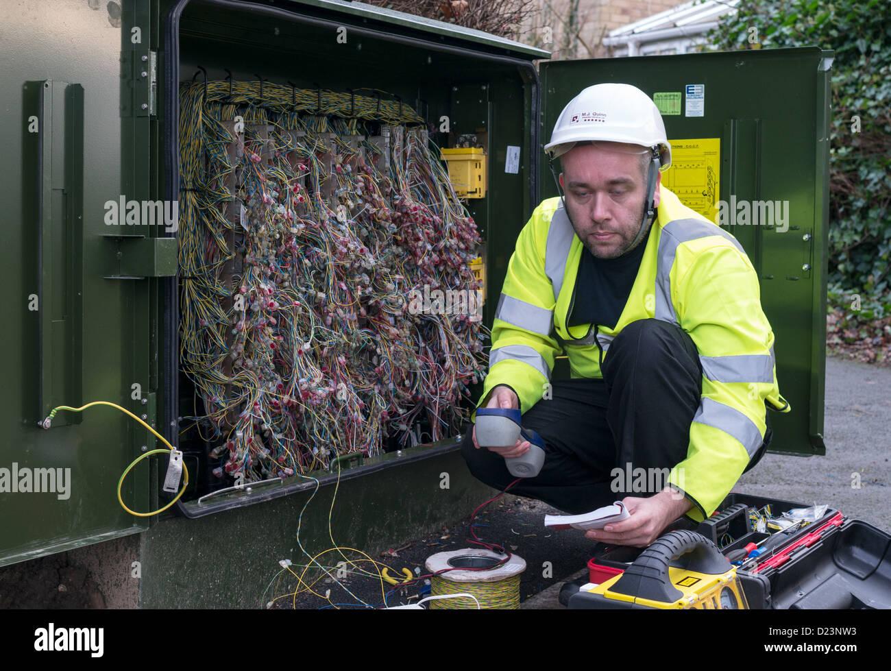 A technician installing fibre optic broadband north east England UK Stock Photo