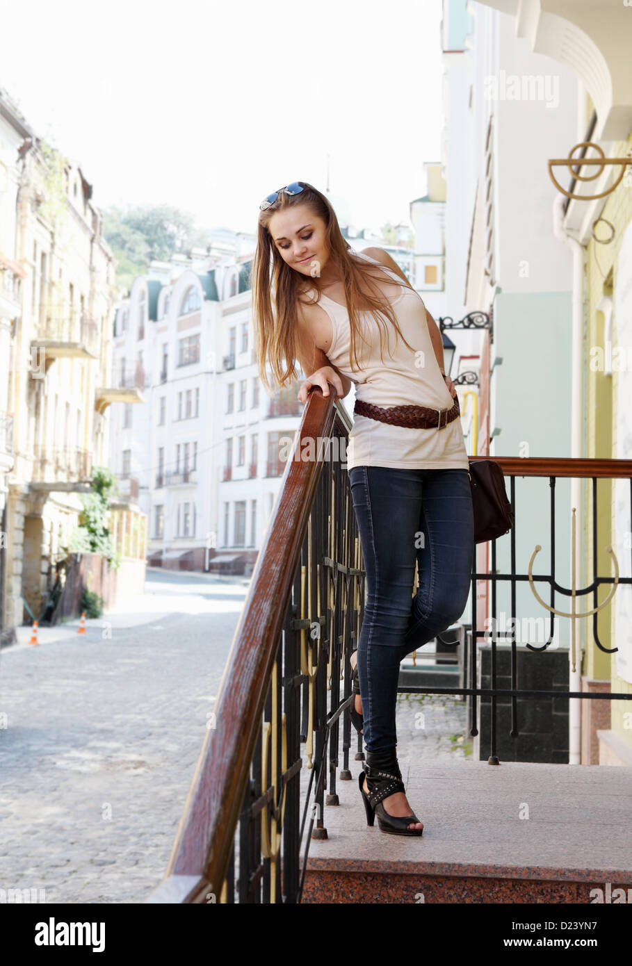 Cute Smiling Young Woman Upstairs Posing Outdoors Stock Photo