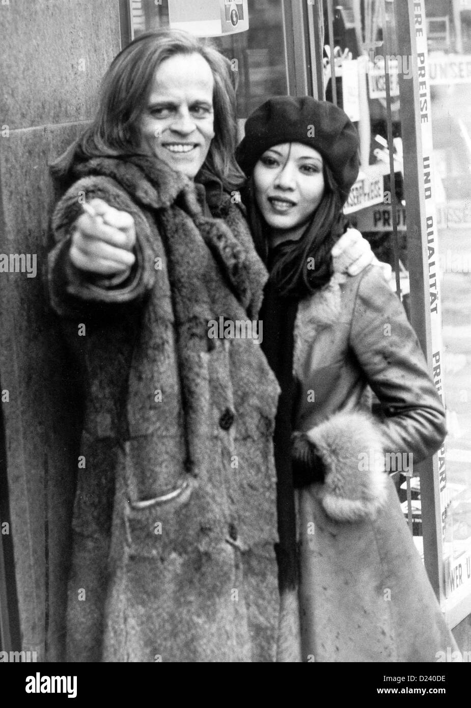 (dpa files) - German actor Klaus Kinski puts his arm around his third wife Vietnamese Genevieve Minhoi during walk in West Berlin 19 November 1971. enfant terrible of film industry Kinski s films include Doctor Zhivago (1965) For Few Dollars More (1966) as well as Aguirre der Zorn Gottes (Aguirre: Wrath of God) Nosferatu: Phantom der Nacht Nosferatu Vampire. Kinski was born on 18 October 1926 in Danzig Germany (now Gdansk Poland) under name of Nikolaus Guenther Nakszynski died on 23 November 1991 in Lagunitas California of heart attack. Stock Photo