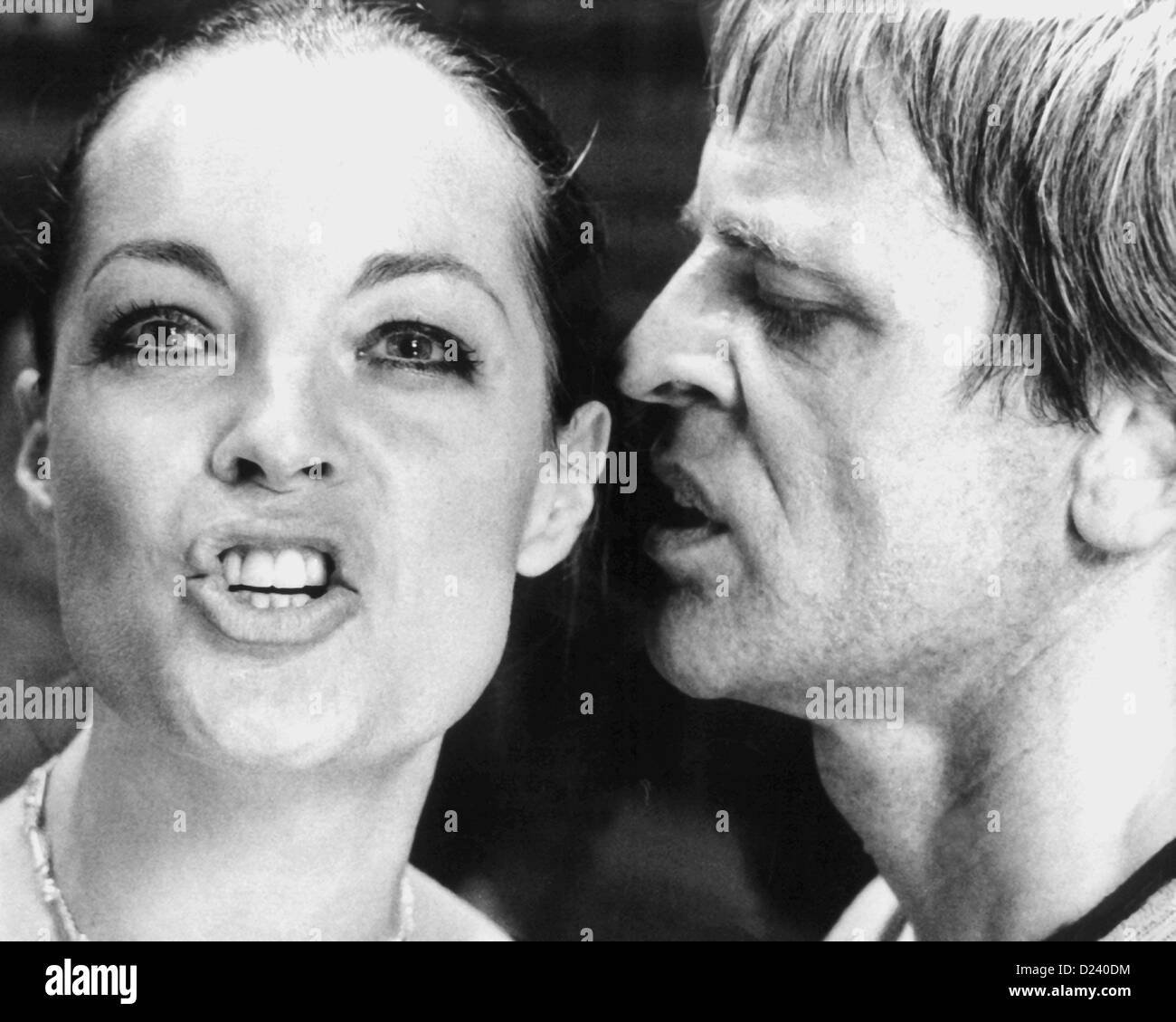(dpa files) - German actor Klaus Kinski and Austrian-born actress Romy Schneider in a movie scene of 'L'Important c'est d'aimer' ('The Main Thing Is to Love'), 1974. Schneider became famous at the age of 17 in the title of role of the trilogy 'Sissi' in the 1950s. Later she starred in films such as 'La piscine' ('The Swimmingpool'/'The Sinners', 1969) and 'Garde a vue' ('Under Suspicion', 1981). Kinski, an 'enfant terrible' of the film industry, starred in such films as 'Fitzcarraldo' and 'Nosferatu: Phantom der Nacht' ('Nosferatu the Vampire'). Stock Photo