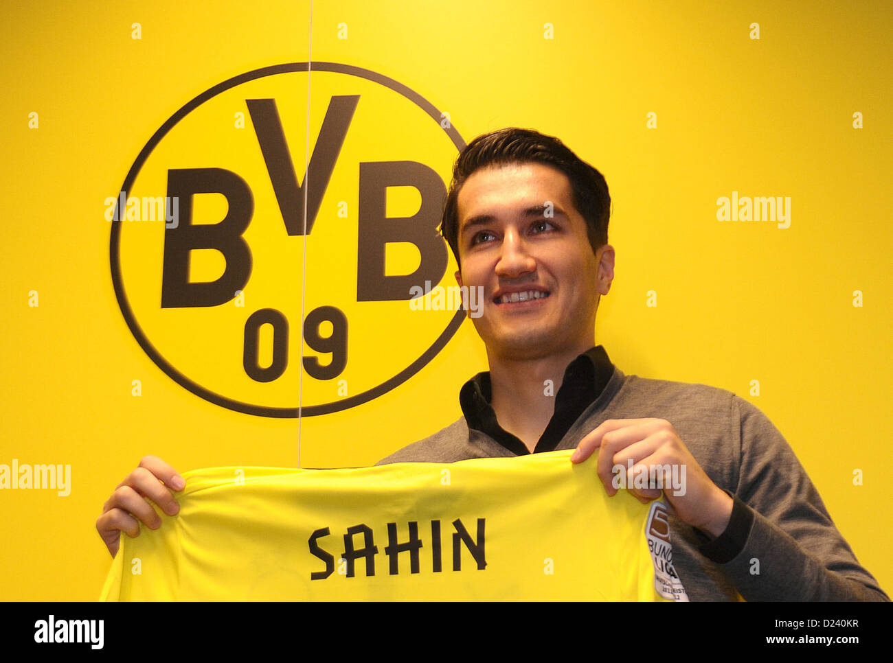 Nuri Sahin is presented as the new acquisition of Bundesliga soccer club Borussia Dortmnd (BVB) and holds up his - Stock Image