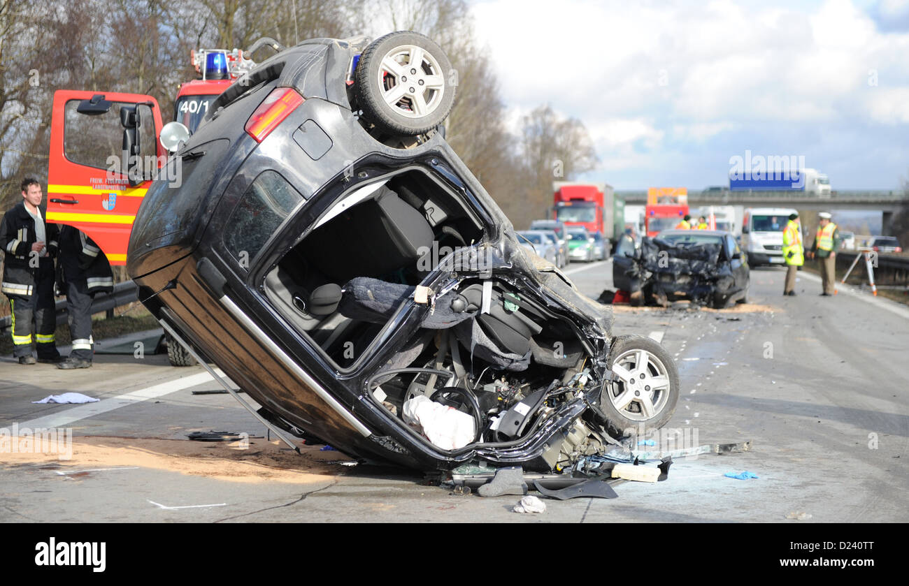 The car of a wrong-way driver lies on its roof after an accident on Autobahn A92 near Freising, Germany, 11 January - Stock Image