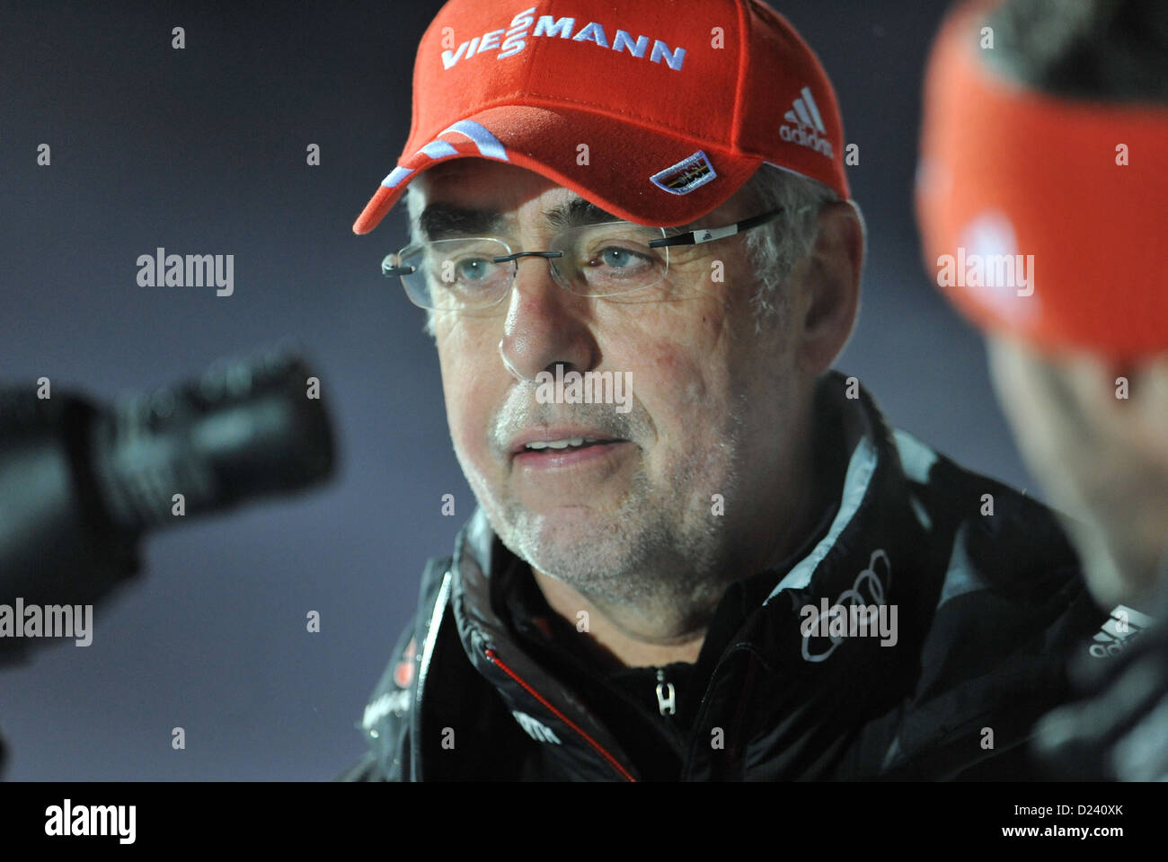 German coach Uwe Mueßiggang seen in the coaching zone during the 4 x 7.5 km relay at the Biathlon World Cup - Stock Image