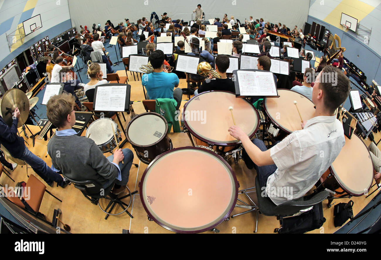The federal youth orchestra rehearse in Colditz, Germany, 7 January 2013. The principle conductor of Dresden's philharmonic Stock Photo