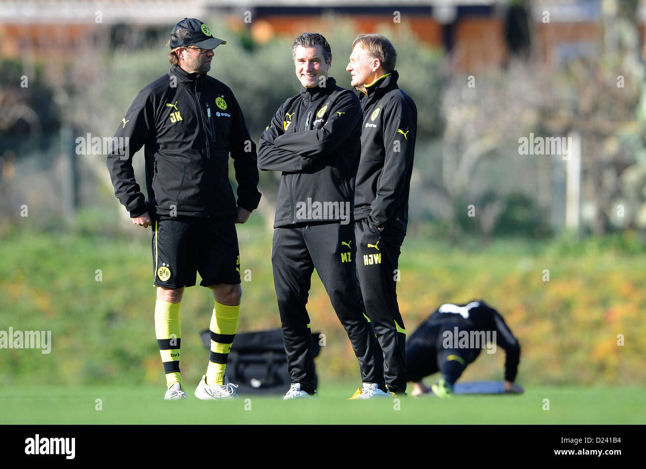 Dortmund's head coach Juergen Klopp (L) talks to sports director Michael Zorc (M) and CEO Hans-Joachim Watzke - Stock Image