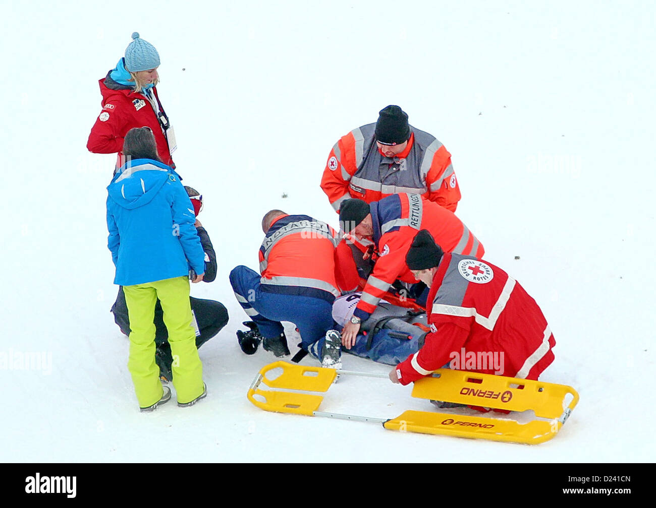 Rescue team helps Austrian ski jumper Daniela Iraschko after her fall during the Ski Jumping World Cup in Hinterzarten, - Stock Image