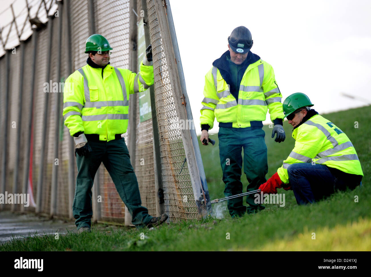 FirstMayor of Hamburg Olaf Scholz (R) symbolically opens the deconstruction of the former customs fence at - Stock Image