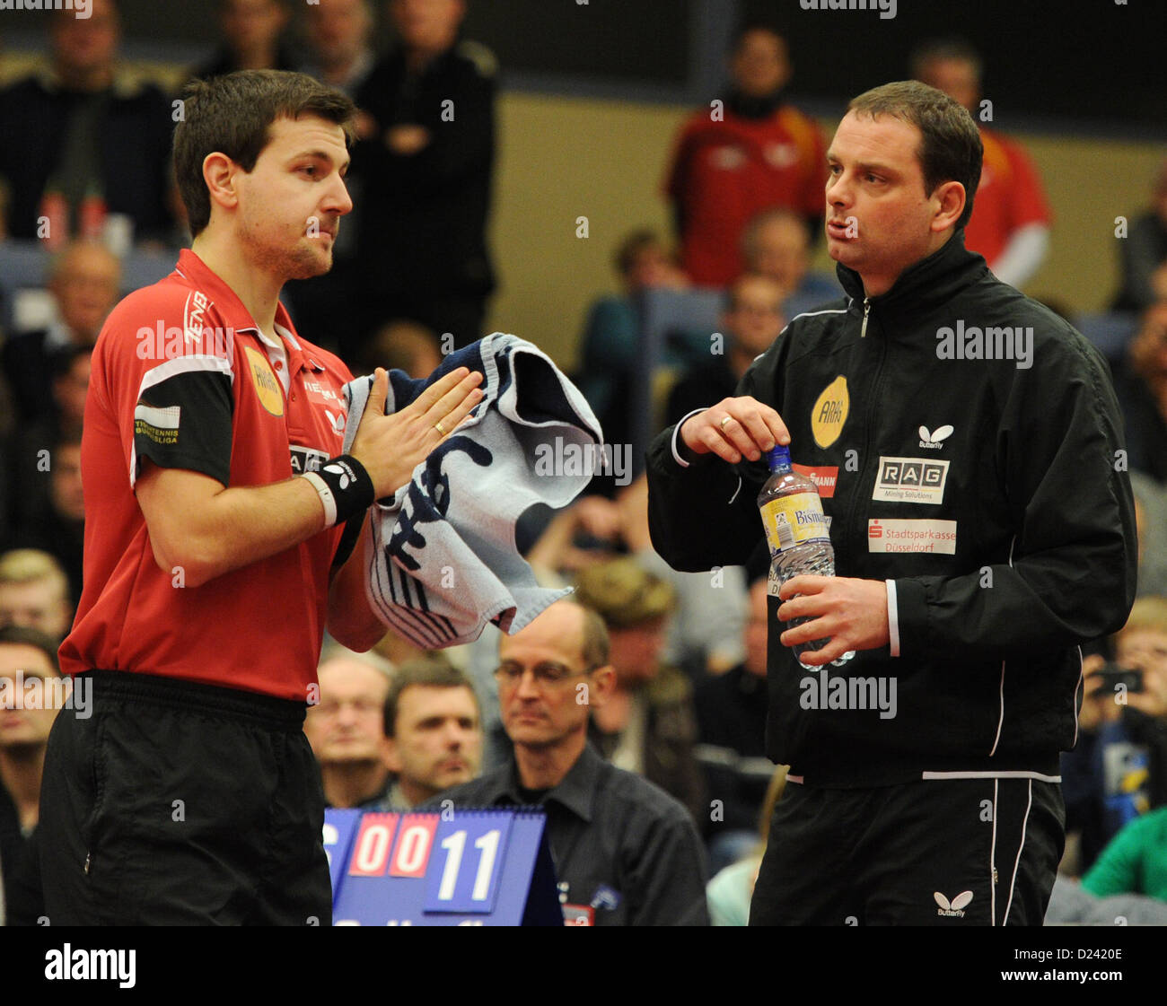 Duesseldorf's TimoBoll (L) talks to his coach Danny Heister during the men's German Bundesliga table - Stock Image