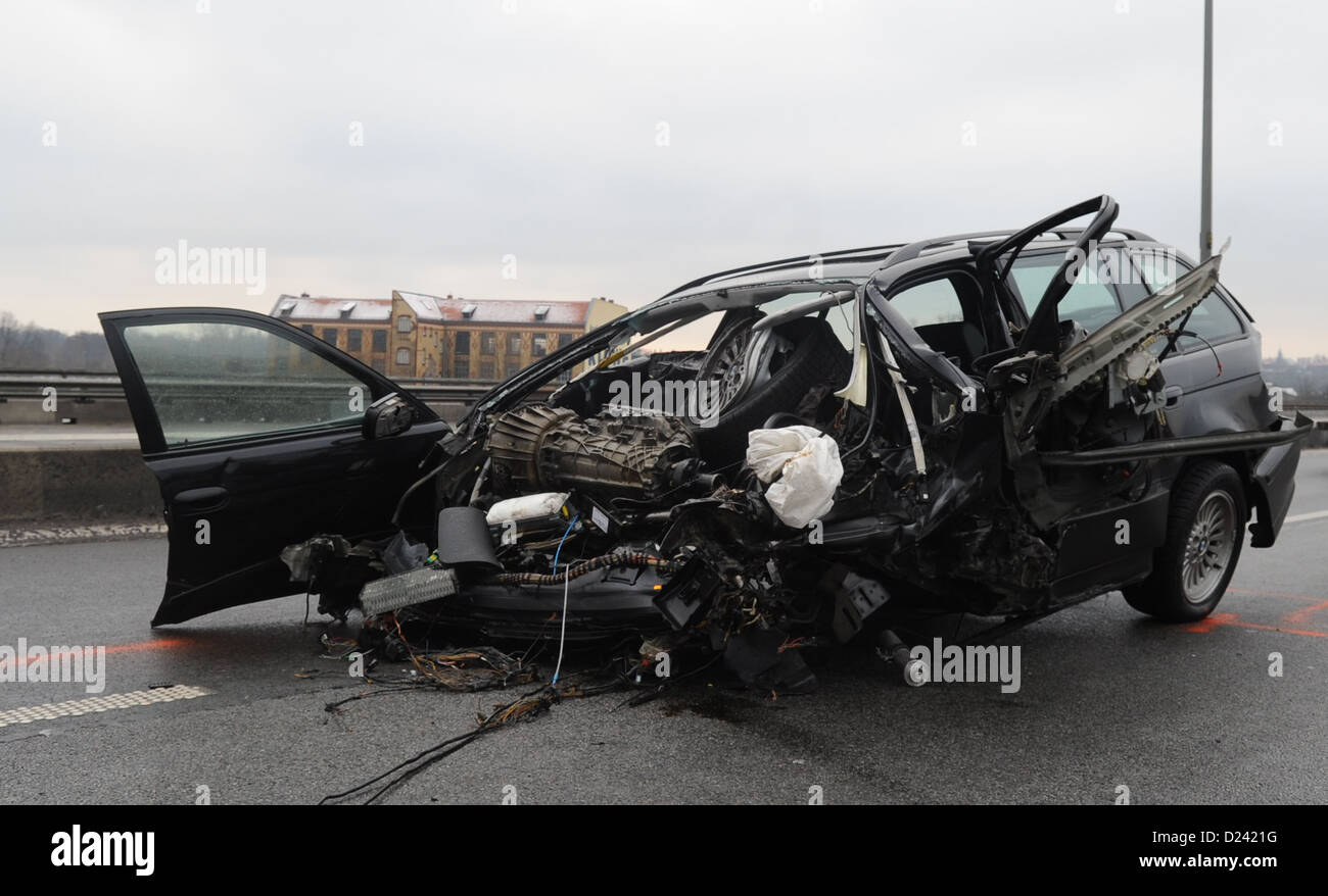 A totally destroyed car is parked on the intercity highway A100 inBerlin, Germany, 13 January 2013. A 46-year - Stock Image