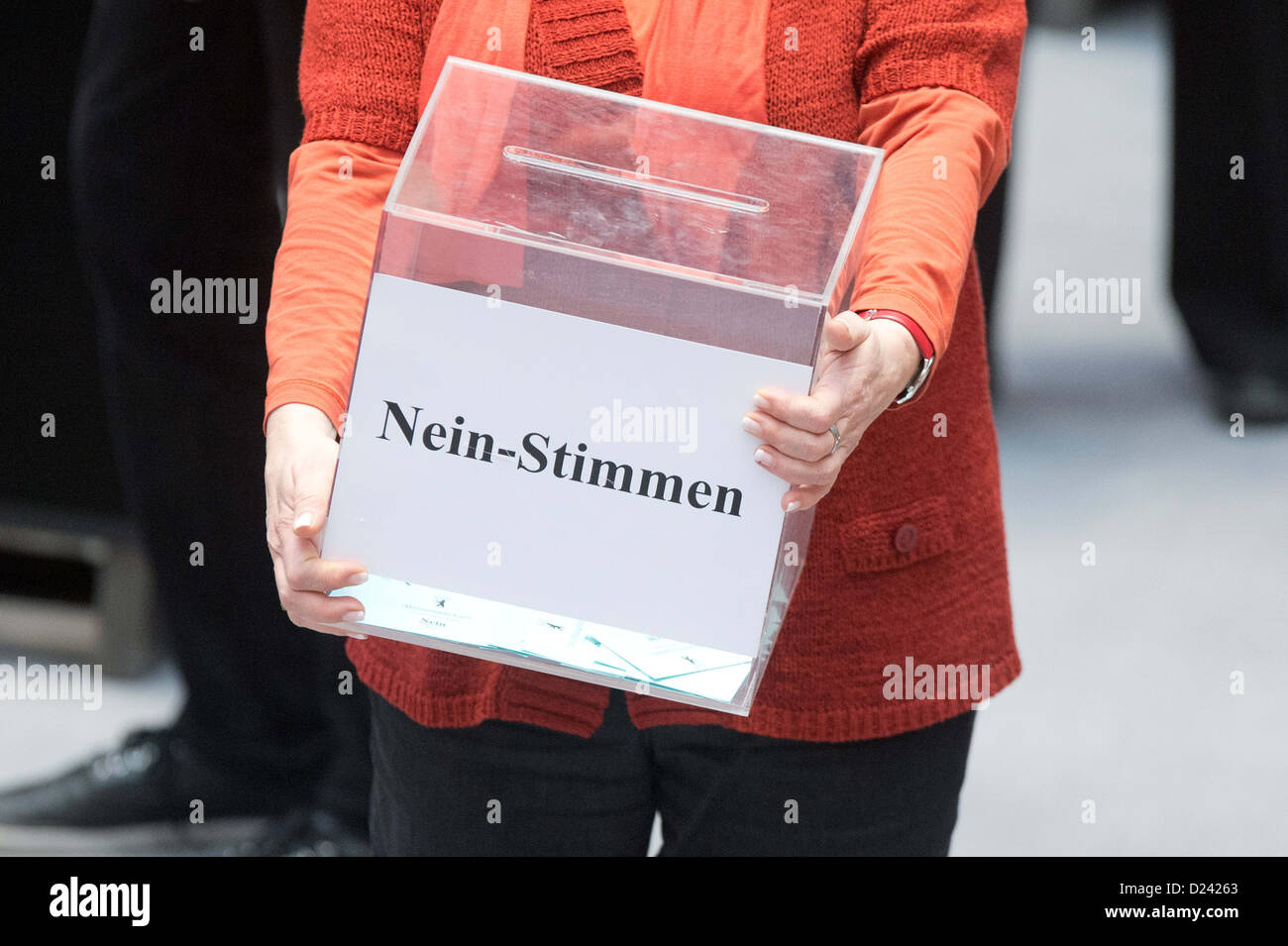 a woman carries a ballot box for the 'no' votes during the state parliament's special meeting concerning - Stock Image