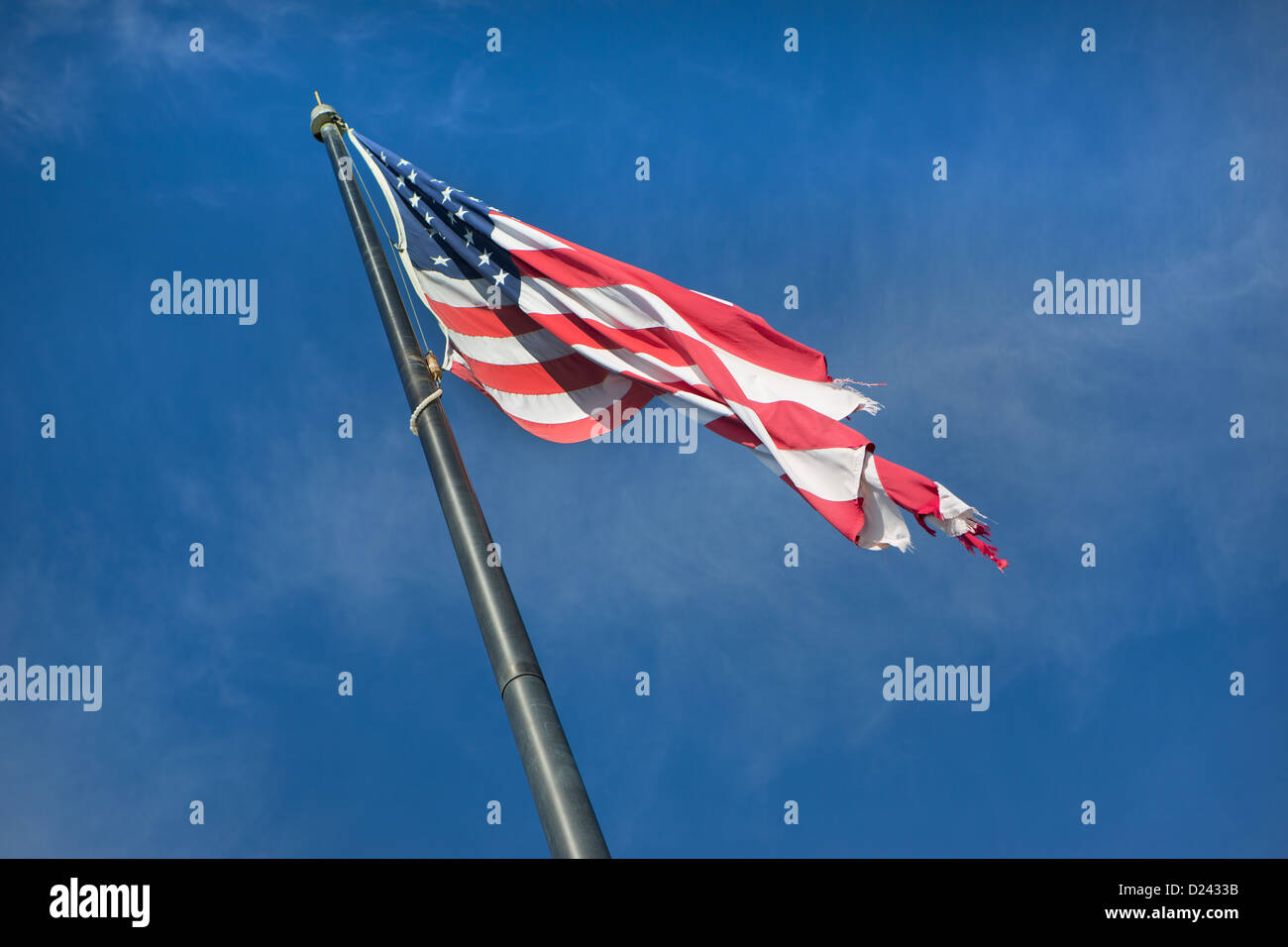 A tattered Stars and Stripes. - Stock Image