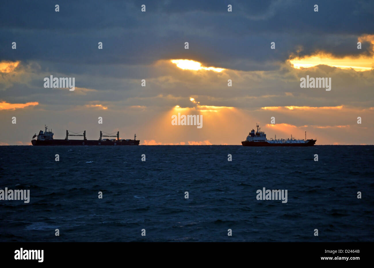 Sunrays over Ships - Stock Image